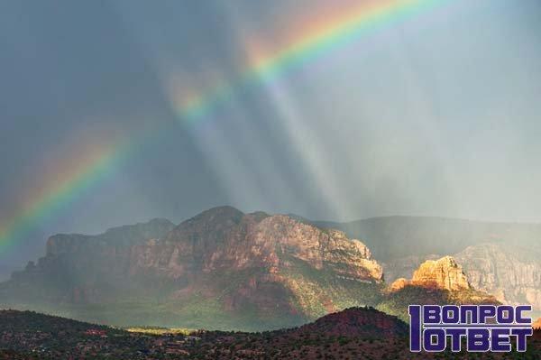 Радуга на горизонте после дождя