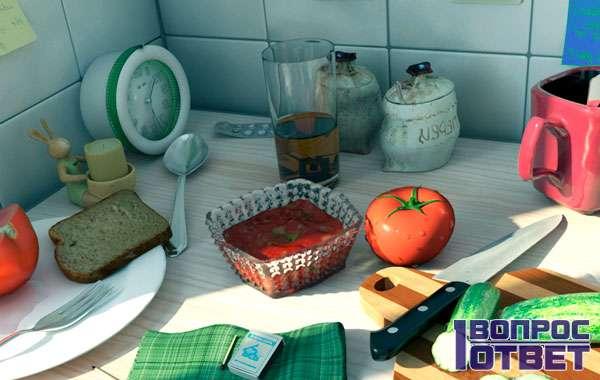 Нож с другой посудой на кухонном столе