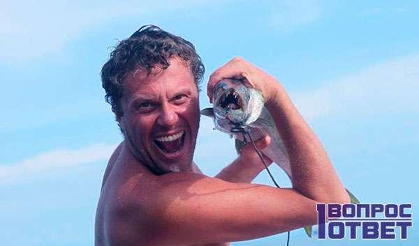 Веселый Сергей Поклонский с рыбой